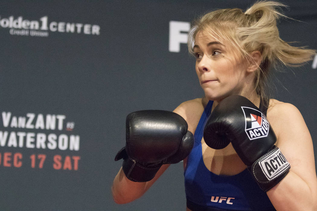Paige VanZant eyes where her next punch will land while hitting mitts during the UFC on Fox 22 open workouts at the Golden 1 Center in Sacramento, Calif. on Dec. 15, 2016. (Heidi Fang/Las Vegas Re ...