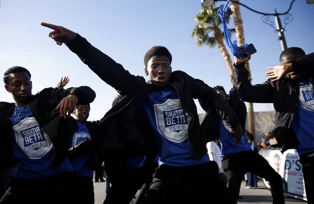 "Thomas Salsberry, a 17-year-old Sigma Beta Club member, dances along with teammates during the 36th annual Dr. Martin Luther King Jr. Parade, themed ""Living the Dream: Building a Bridge to Unity""  ..."
