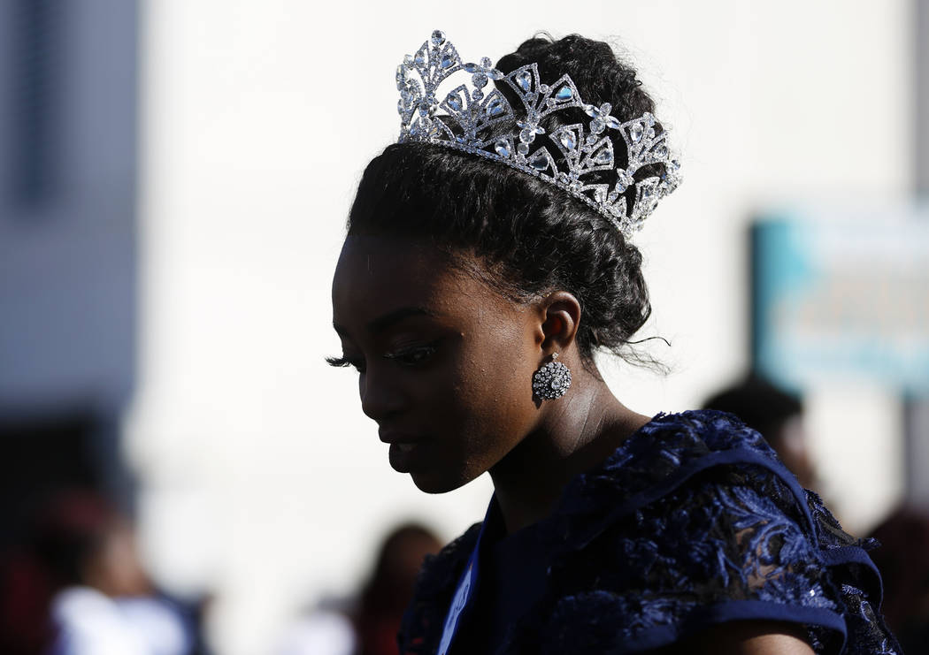 "Itohan Osayaren, the 2018 Miss Black Nevada, attends the 36th annual Dr. Martin Luther King Jr. Parade, themed ""Living the Dream: Building a Bridge to Unity,"" in downtown Las Vegas, Jan. 15, 2018. ..."