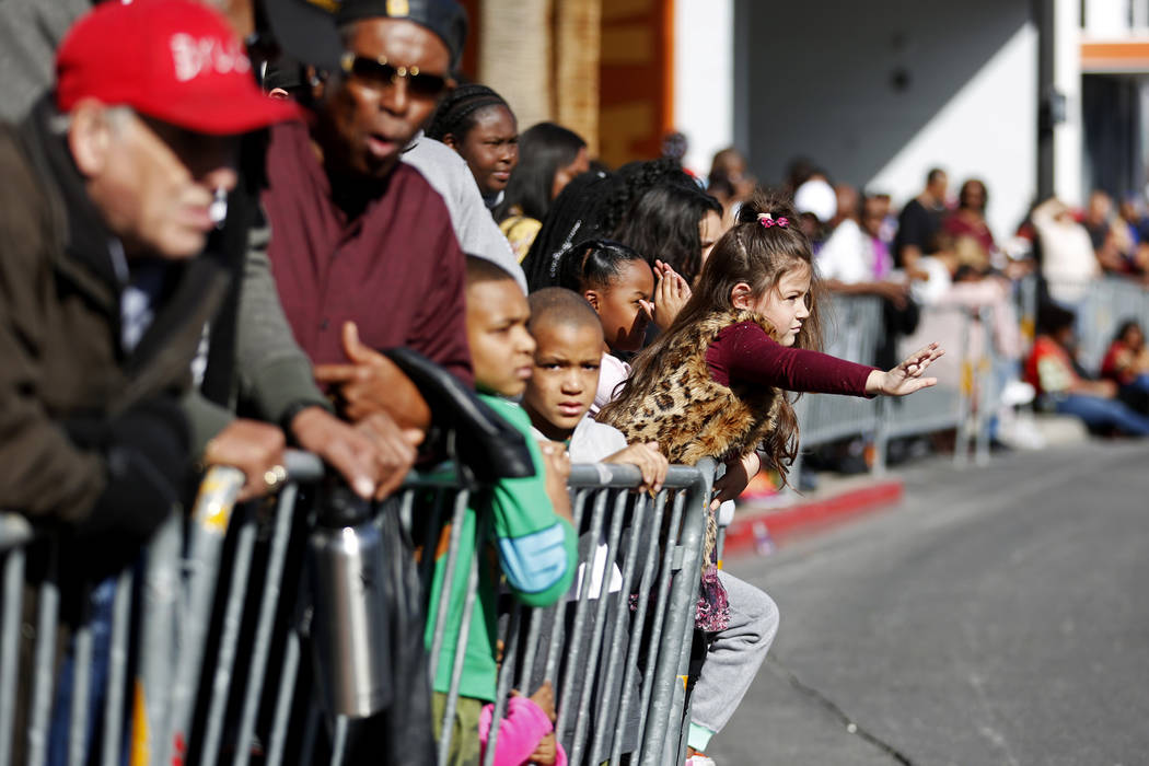 "Attendees watch the 36th annual Dr. Martin Luther King Jr. Parade, themed ""Living the Dream: Building a Bridge to Unity,"" in downtown Las Vegas, Jan. 15, 2018. The parade featured floats, dancers, ..."