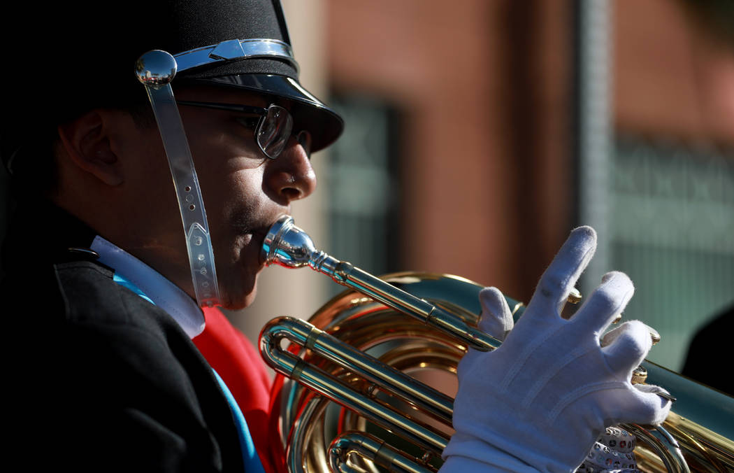 "Carlos Lemus, a 15-year-old baritone player from Western High School, practices before marching in the 36th annual Dr. Martin Luther King Jr. Parade, themed ""Living the Dream: Building a Bridge to ..."