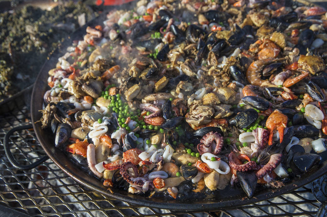 Paella of seafood and chicken pate de campaign from chef Julien Asseo at Guy Savoy cooks on the open fire during Whiskey in the Wilderness 2 on Sunday, January 14, 2018, at Spring Mountain Ranch S ...