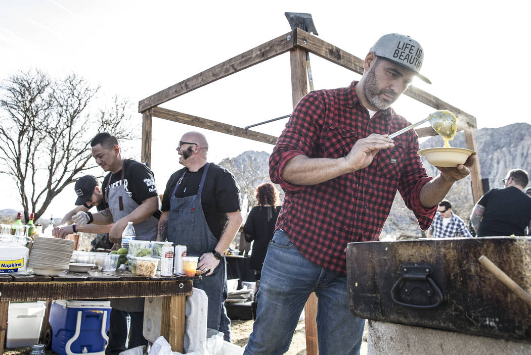 Vincent Rotolo prepares chicken arroz caldo from chef John Courtney at Echo & Rig during Whiskey in the Wilderness 2 on Sunday, January 14, 2018, at Spring Mountain Ranch State Park, in Las Ve ...