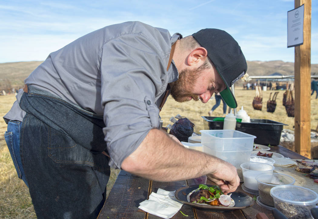 Chef Justin Kingsley Hall, with The Kitchen at Atomic, prepares a cape grim tomahawk taco with Hudson Valley foie gras mole during Whiskey in the Wilderness 2 on Sunday, January 14, 2018, at Sprin ...