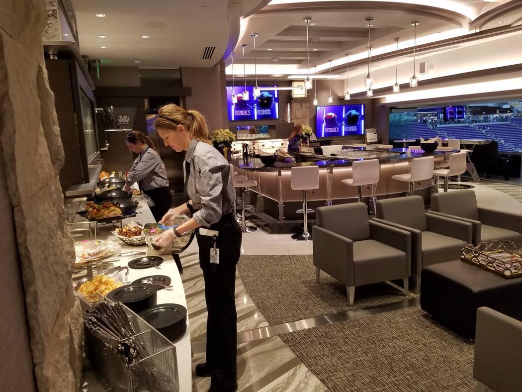 Food servers prepare a buffet in one of U.S. Bank Stadium's 131 luxury suites on Sunday, Dec. 17, 2017, prior to the Cincinnati Bengals-Minnesota Vikings game.  Richard N. Velotta/Las Vegas Review ...