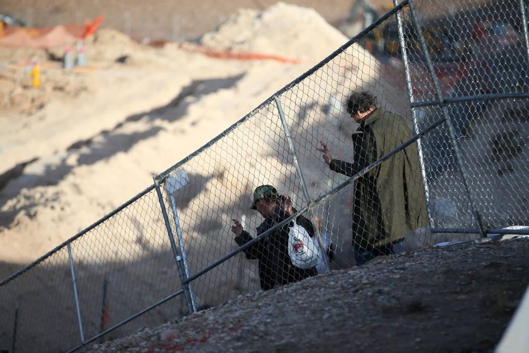 People descent along the perimeter of the construction site of the future Raiders football stadium in Las Vegas, Tuesday, Jan. 16, 2018. Erik Verduzco Las Vegas Review-Journal @Erik_Verduzco
