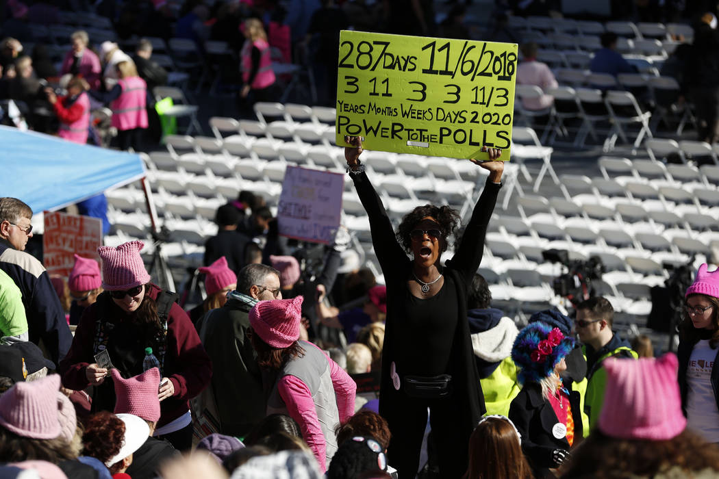 Nyla Christian, 50, dances and cheers before the Power to the Polls event, hosted by the Women's March, at the Sam Boyd Stadium in Las Vegas, Sunday, Jan. 21, 2018. The event, which served as an a ...