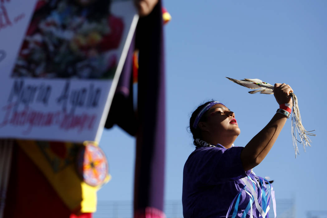 A woman dances during the Power to the Polls event, hosted by the Women's March, at the Sam Boyd Stadium in Las Vegas, Jan. 21, 2018. The event, which served as an advocacy tool to register new vo ...