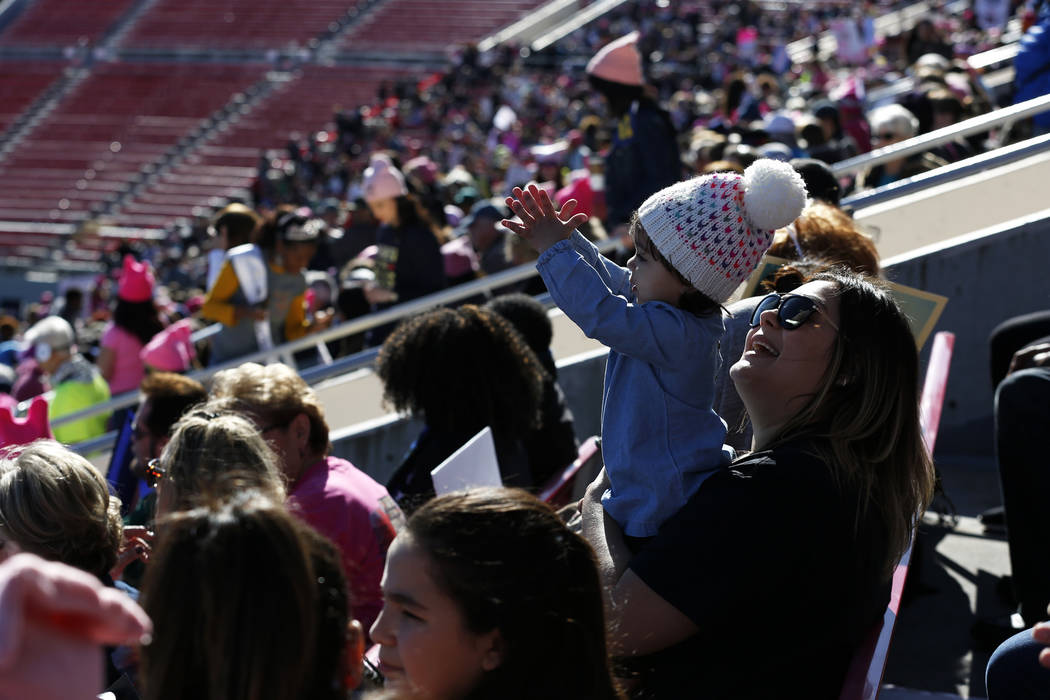 Attendees cheer during the Power to the Polls event, hosted by the Women's March, at the Sam Boyd Stadium in Las Vegas, Jan. 21, 2018. The event, which served as an advocacy tool to register new v ...