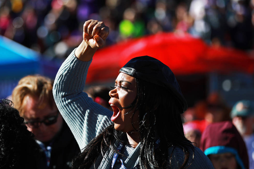 Jacqueline Reynolds cheers for speakers during the Power to the Polls event, hosted by the Women's March, at the Sam Boyd Stadium in Las Vegas, Jan. 21, 2018. The event, which served as an advocac ...