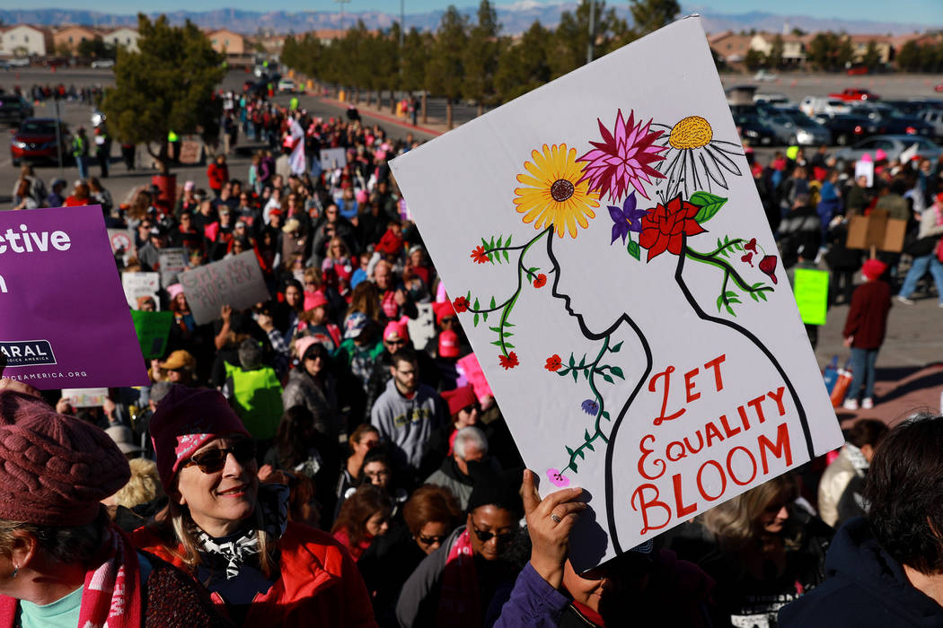 Crowds gather for the Power to the Polls event, hosted by the Women's March, at the Sam Boyd Stadium in Las Vegas, Jan. 21, 2018. The event, which served as an advocacy tool to register new voters ...