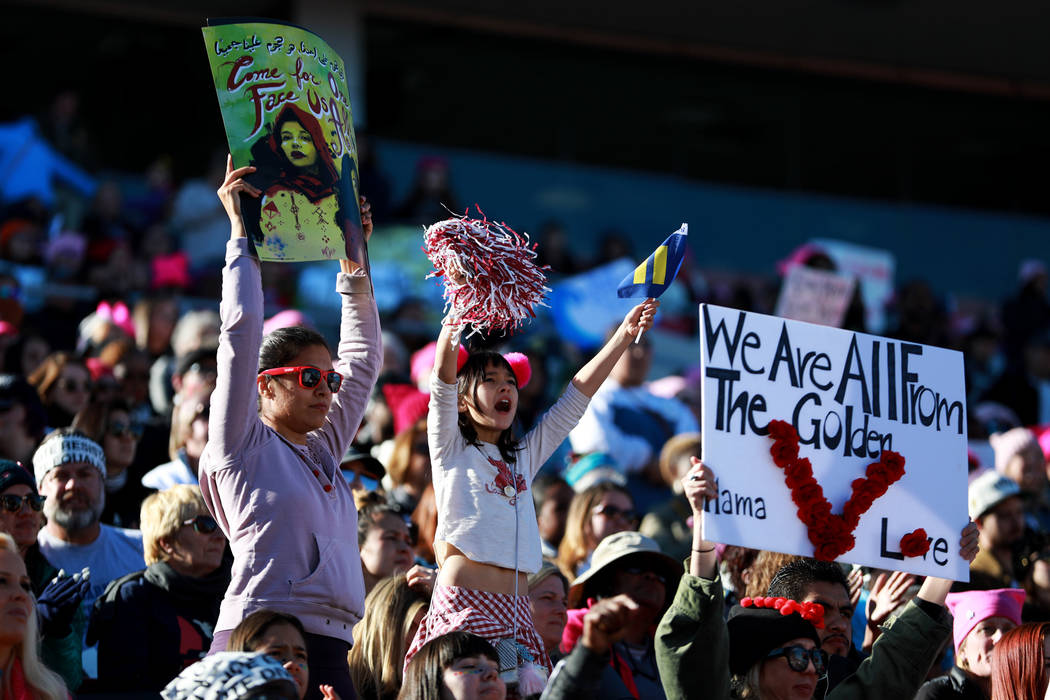 Attendees cheer for the Power to the Polls event, hosted by the Women's March, at the Sam Boyd Stadium in Las Vegas, Jan. 21, 2018. The event, which served as an advocacy tool to register new vote ...
