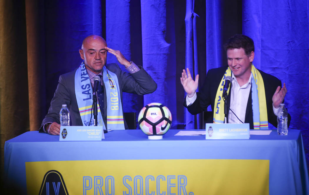 Jose Luis Sanchez Sola, also known as as Chelis, speaks alongside team owner Brett Lashbrook during Sola's first press conference as coach of the Las Vegas Lights FC at Inspire Theater in downtown ...