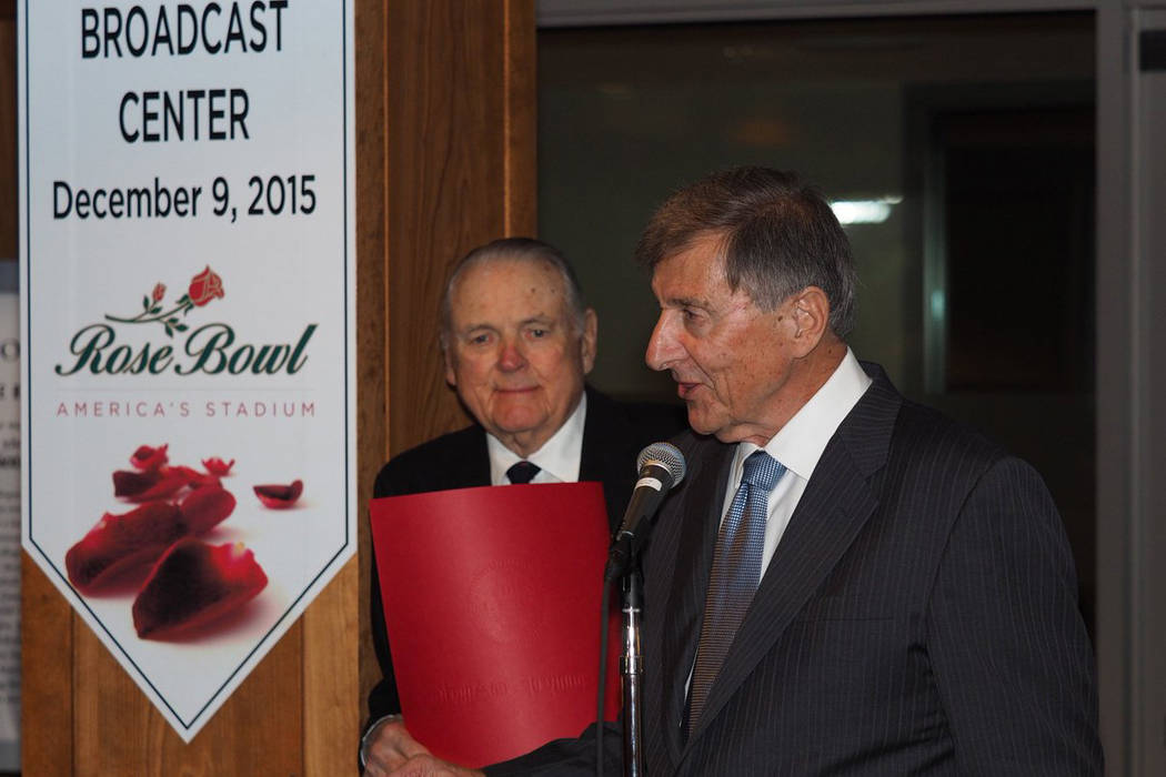Former UNLV football coach Harvey Hyde, right, introduces friend Keith Jackson at the dedication of the Keith Jackson Broadcast Center at the Rose Bowl in Pasadena, California, on Dec. 9, 2015. (C ...