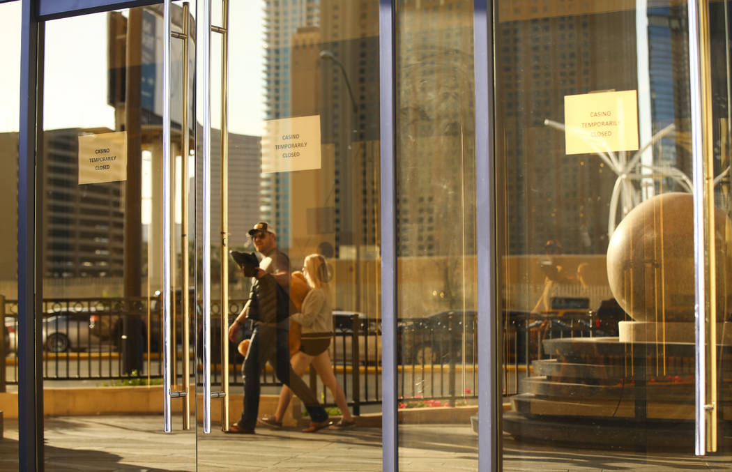 Pedestrians walk by an entrance to Lucky Dragon, which shut down gaming and casino restaurant operations in early Jan., in Las Vegas on Monday, Jan. 15, 2018. (Chase Stevens/Las Vegas Review-Journ ...
