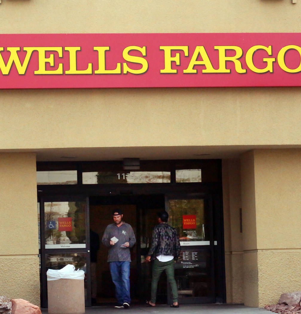 Customers Enter And Exit A Wells Fargo Branch At 1121 Las Vegas Blvd South On Tuesday