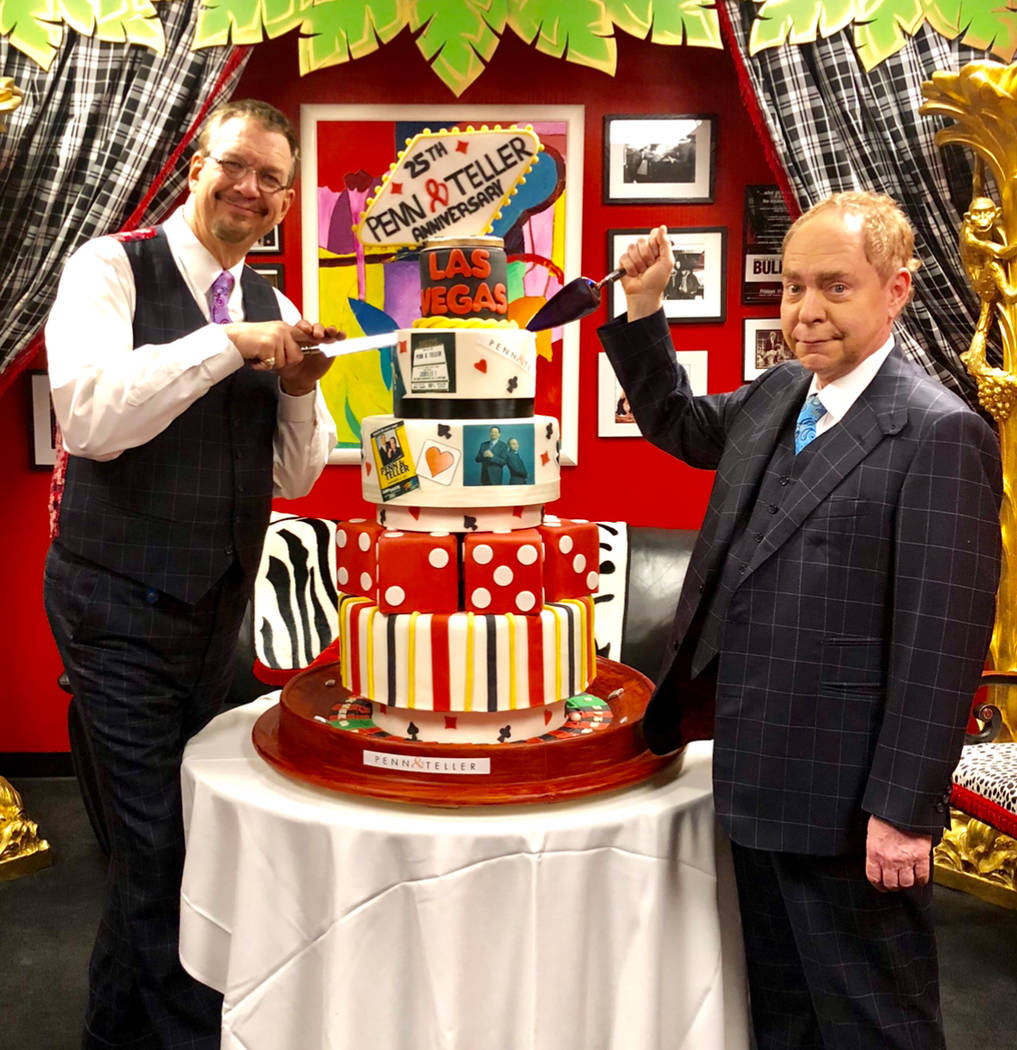 Penn & Teller are shown with a large cake at the RIo, commemorating their 25th anniversary of performing in Las Vegas, on Sunday, Jan. 14, 2018. (Glenn Alai)