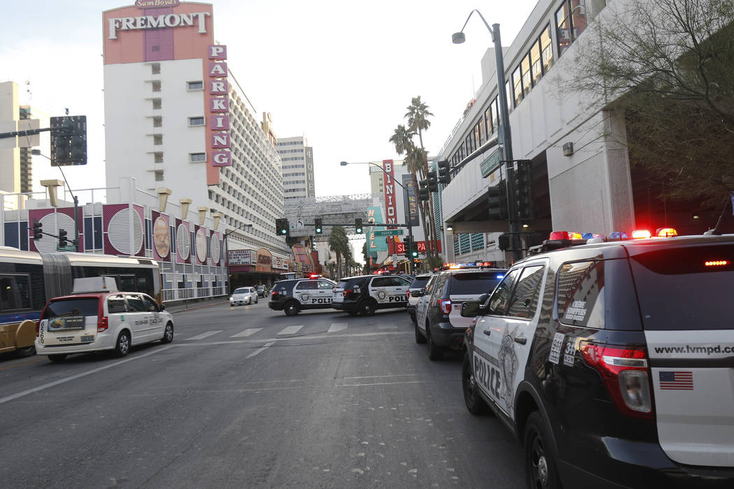 Cop cars on Ogden and Casino Center near the Fremont Street Experience in Las Vegas, Monday, Jan. 15, 2018. A large fight occurred nearby with around 100 people involved and eight were detained, a ...