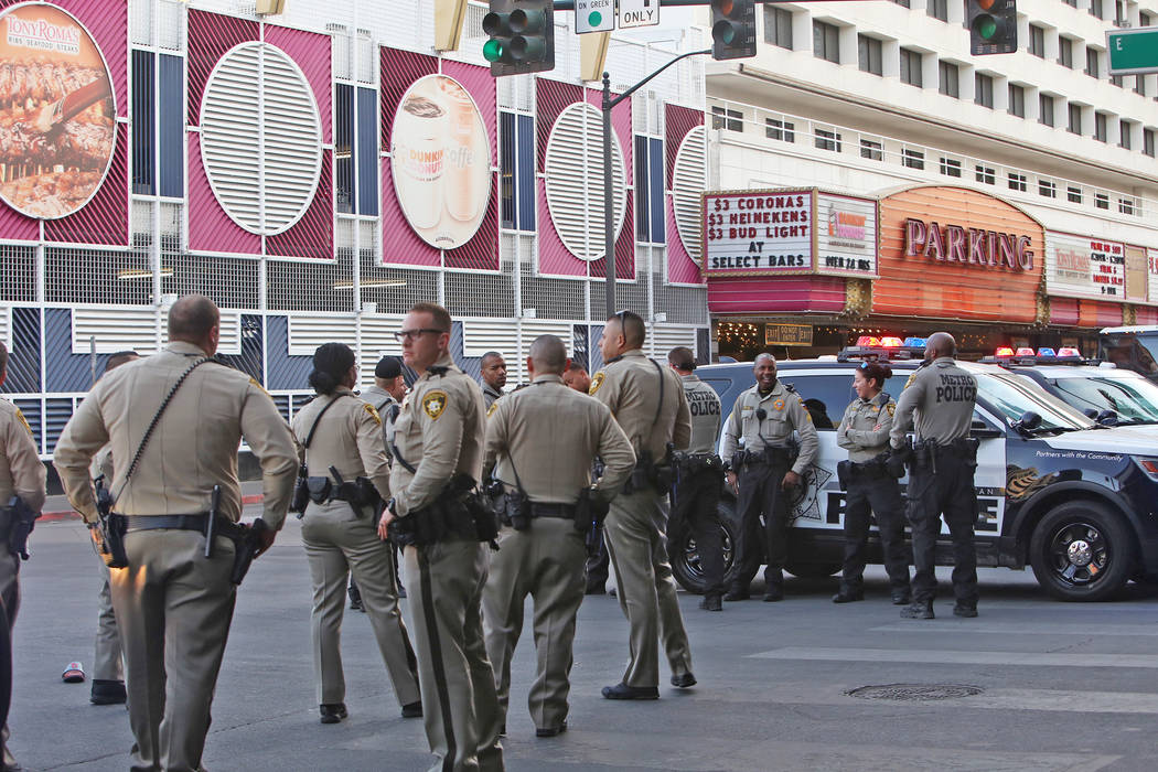 Metro police on Ogden and Casino Center near the Fremont Street Experience in Las Vegas, Monday, Jan. 15, 2018. A large fight occurred nearby with around 100 people involved and eight were detaine ...