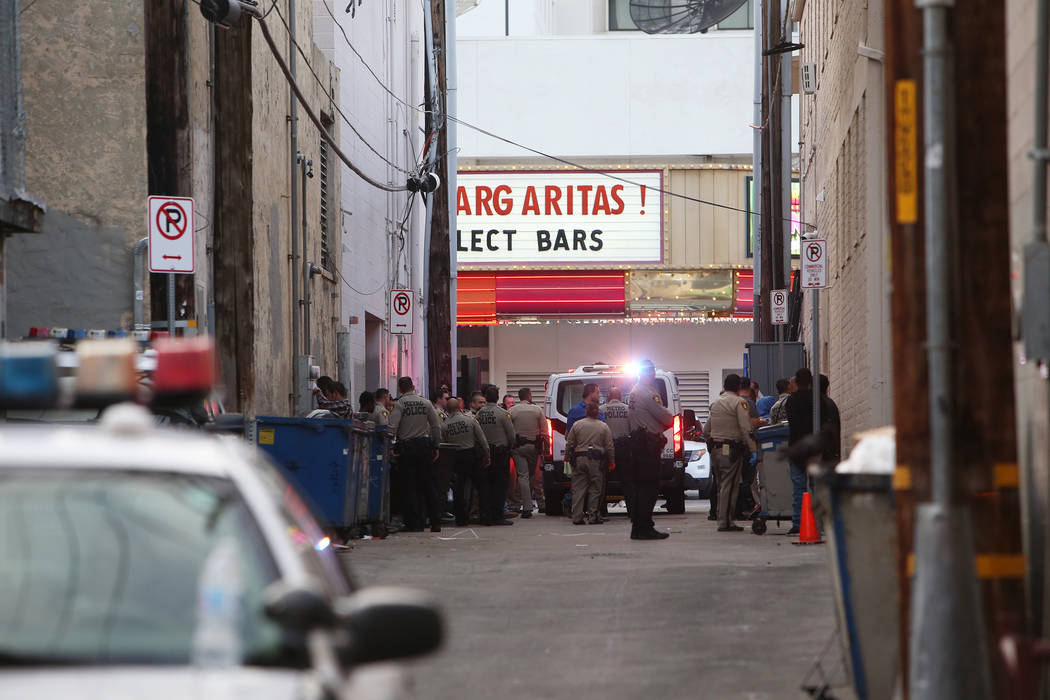 Metro Police in an alley near the Fremont Street Experience in Las Vegas, Monday, Jan. 15, 2018. A large fight occurred nearby with around 100 people involved and eight were detained, according to ...