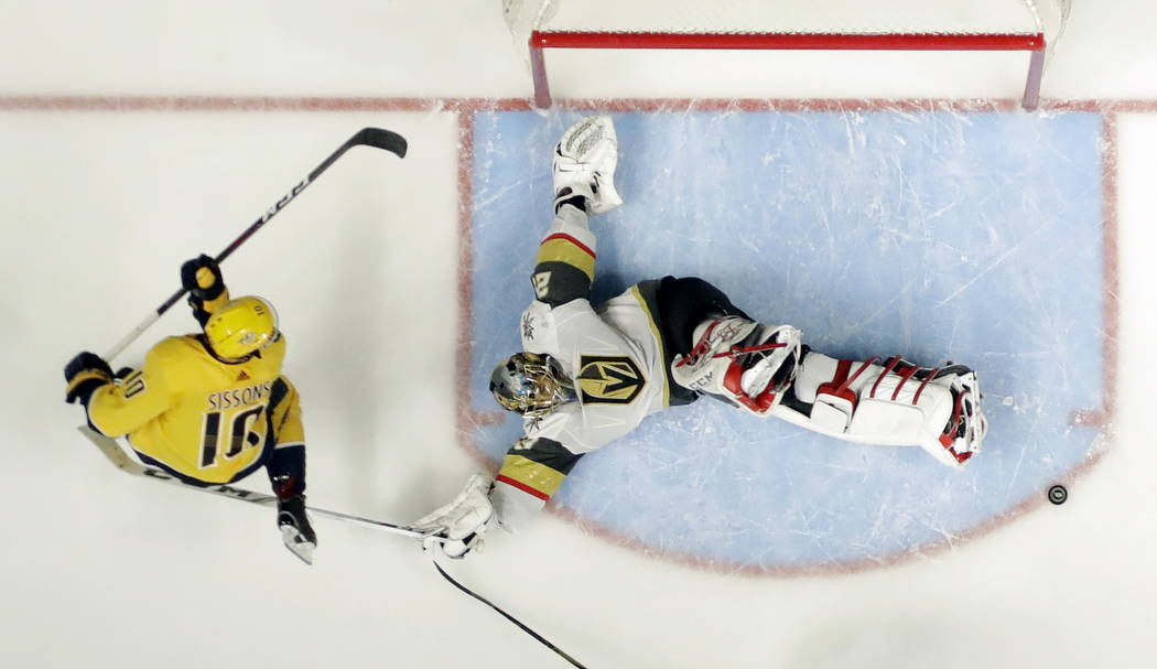 Vegas Golden Knights goalie Marc-Andre Fleury blocks a shot by Nashville Predators center Colton Sissons (10) in the third period of an NHL hockey game Tuesday, Jan. 16, 2018, in Nashville, Tenn.  ...