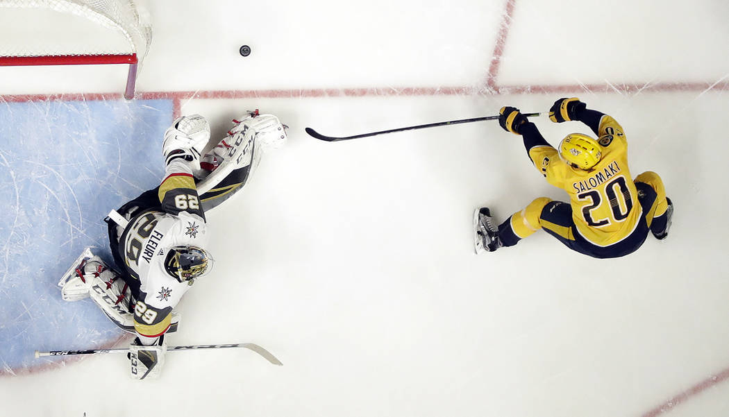 Vegas Golden Knights goalie Marc-Andre Fleury (29) blocks a shot by Nashville Predators right wing Miikka Salomaki (20), of Finland, in the first period of an NHL hockey game Tuesday, Jan. 16, 201 ...
