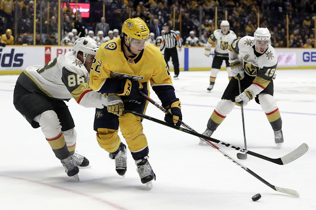 Nashville Predators left wing Kevin Fiala (22), of Switzerland, is defended by Vegas Golden Knights' Nate Schmidt (88) in the second period of an NHL hockey game Tuesday, Jan. 16, 2018, in Nashvil ...