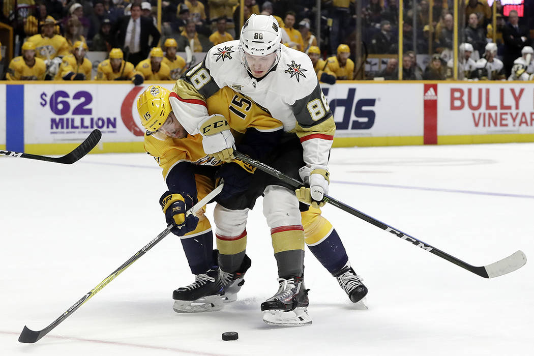 Nashville Predators right wing Craig Smith (15) and Vegas Golden Knights defenseman Nate Schmidt (88) get tangled together in the second period of an NHL hockey game Tuesday, Jan. 16, 2018, in Nas ...