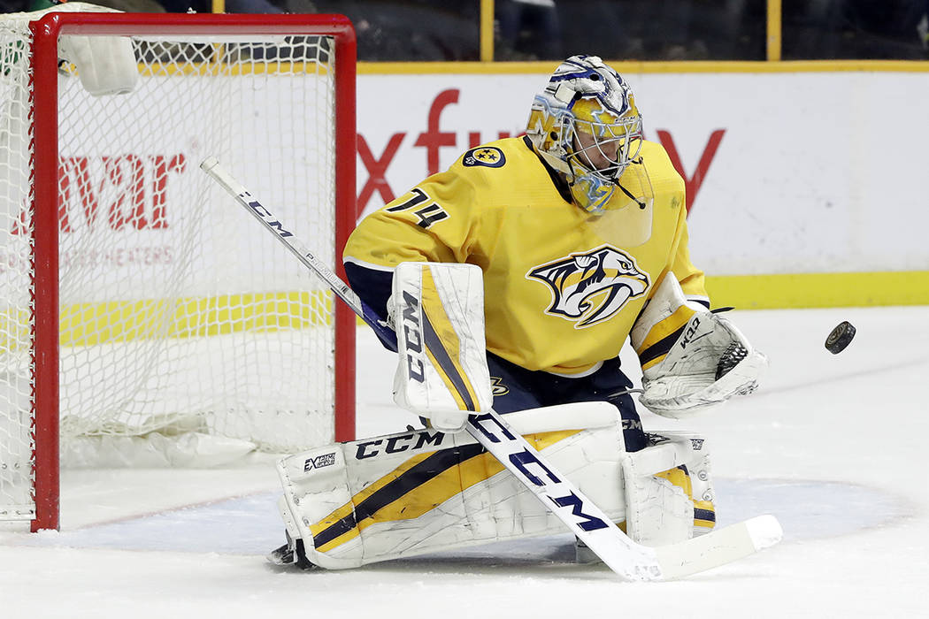 Nashville Predators goalie Juuse Saros, of Finland, blocks a shot against the Vegas Golden Knights in the first period of an NHL hockey game Tuesday, Jan. 16, 2018, in Nashville, Tenn. (AP Photo/M ...