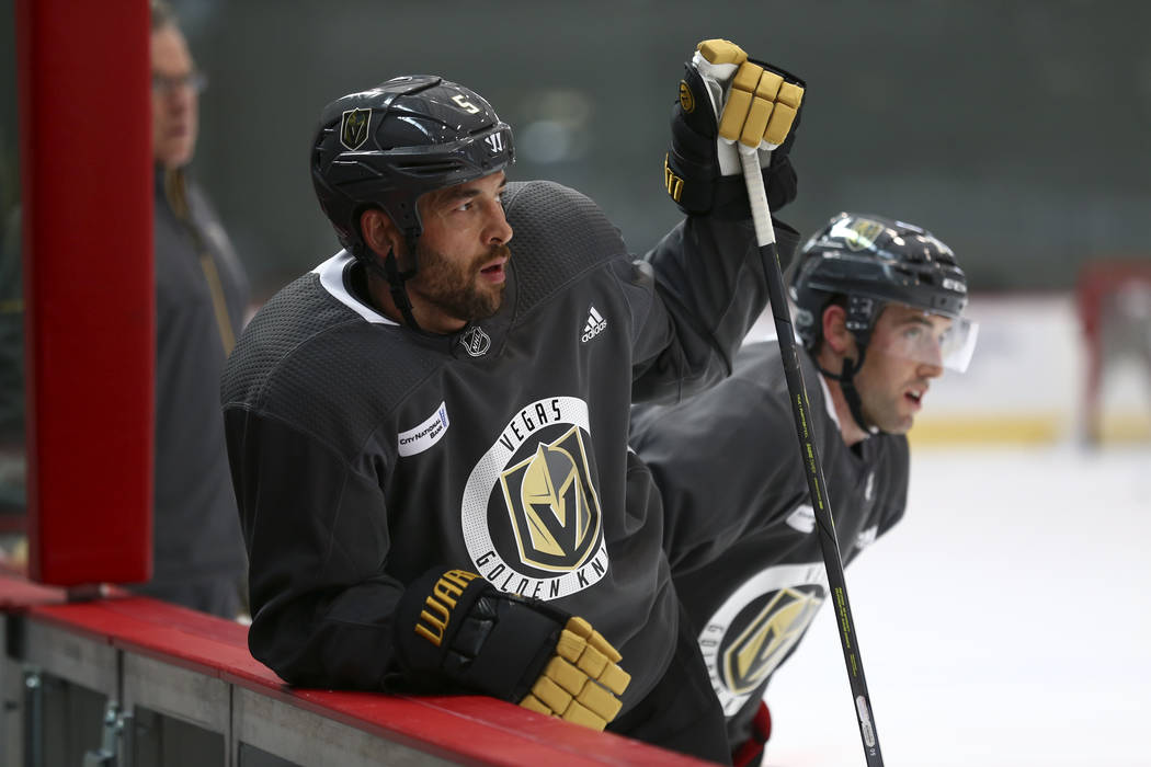 Vegas Golden Knights defenseman Deryk Engelland (5) and Knights defenseman Brad Hunt (77) on the ice during the NHL team's practice at the City National Arena in Las Vegas, Wednesday, Oct. 4, 2017 ...