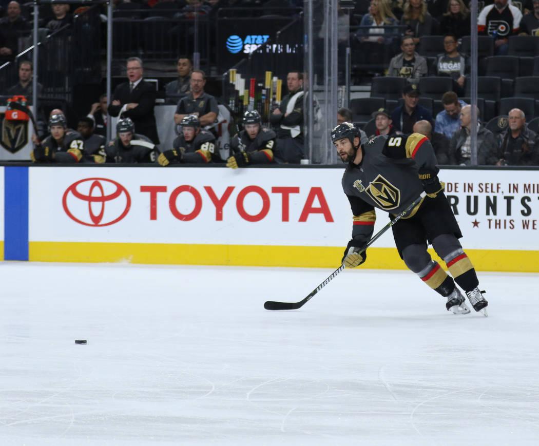 Vegas Golden Knights defenseman Deryk Engelland (5) handles the puck during the first period of a NHL game against the Carolina Hurricanes in Las Vegas, Tuesday, Dec. 12, 2017. Heidi Fang Las Vega ...