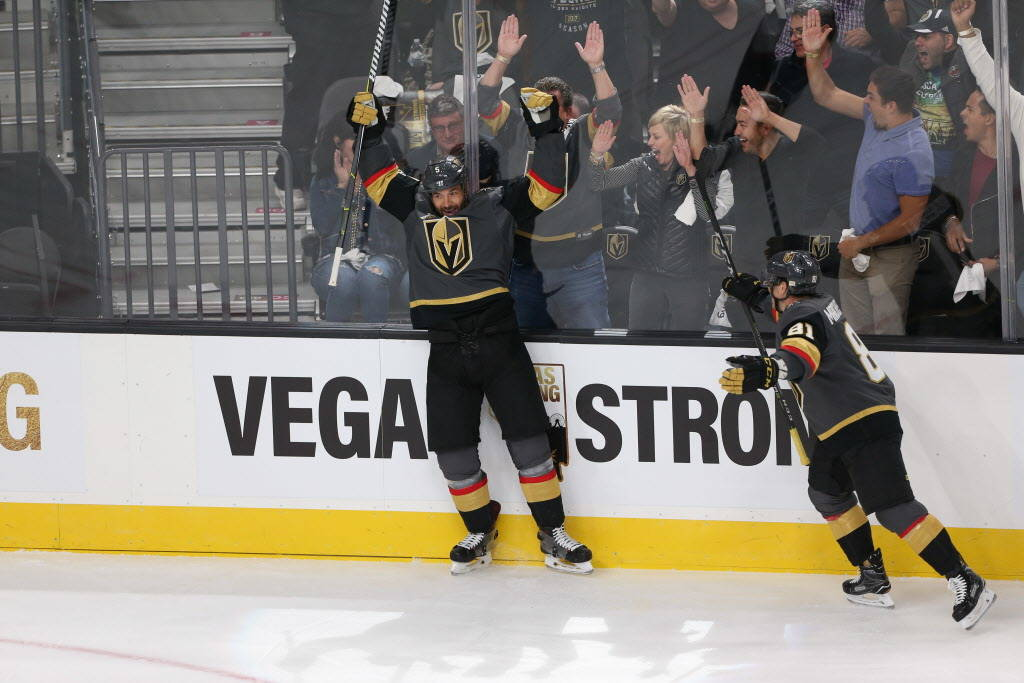 Vegas Golden Knights defenseman Deryk Engelland (5) raises his arms after his score in the NHL season home opener against the Arizona Coyotes at T-Mobile Arena in Las Vegas, Tuesday, Oct. 10, 2017 ...