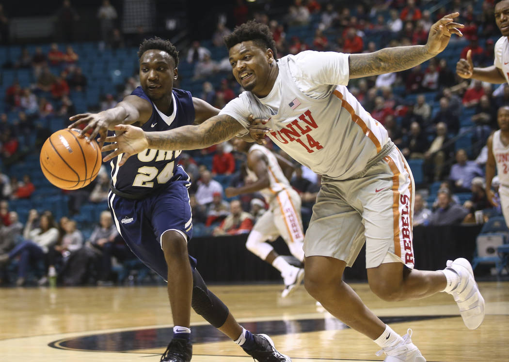 UNLV's Tervell Beck (14) goes for a loose ball against Oral Roberts' R.J. Fuqua (24) during their basketball game at the MGM Grand Garden Arena in Las Vegas on Tuesday, Dec. 5, 2017. UNLV won 92-6 ...