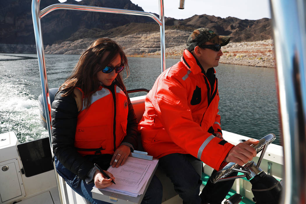 From left, Nichelle Rich, 33, and Ben Smith, 30, partake in a bald eagle survey at Lake Mead National Recreation Area, Wednesday, Jan. 17, 2018. Survey teams set out at dawn to survey the local ba ...