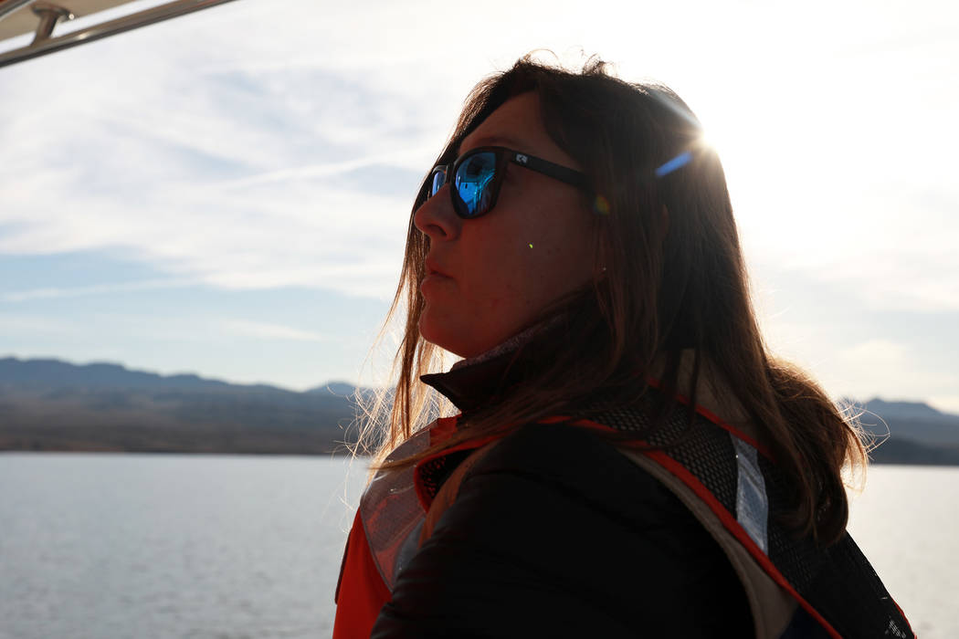 Nichelle Rich, 33, scans the sky for bald eagles at Lake Mead National Recreation Area, Wednesday, Jan. 17, 2018. Survey teams set out at dawn to survey the local bald eagle population as part of  ...