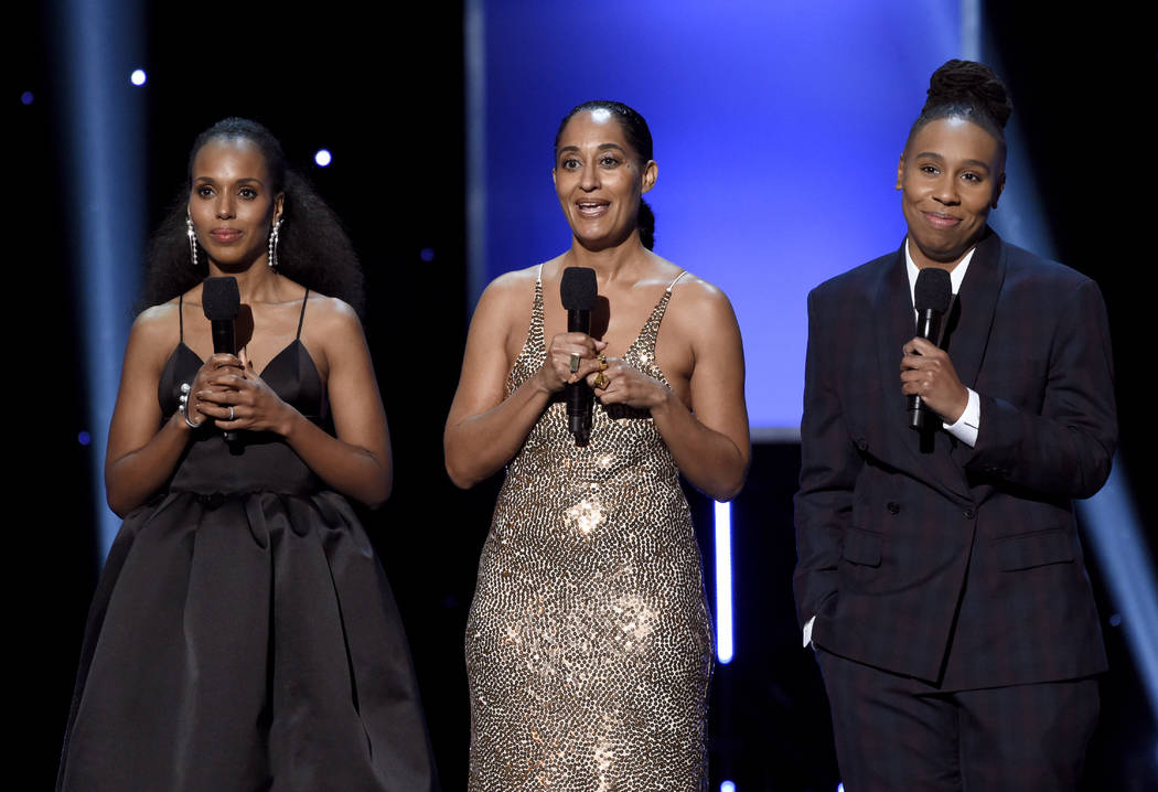 Kerry Washington, from left, Tracee Ellis Ross, and Lena Waithe present the award for outstanding actress in a motion picture at the 49th annual NAACP Image Awards at the Pasadena Civic Auditorium ...