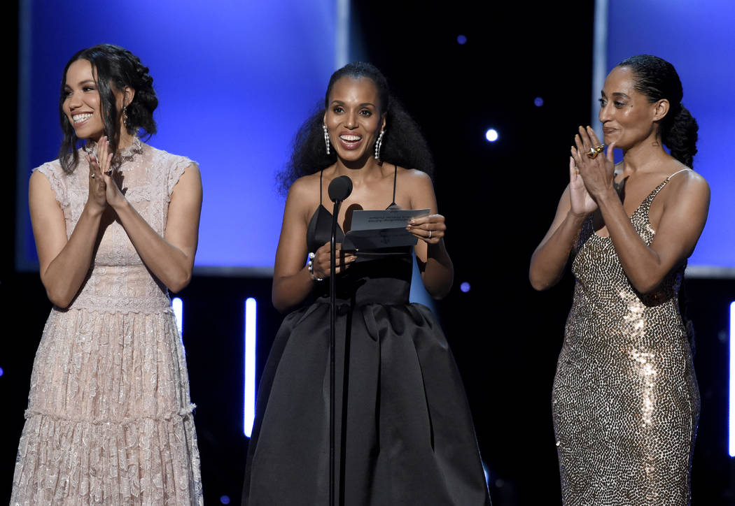 Jurnee Smollett-Bell, from left, Kerry Washington, and Tracee Ellis Ross present the award for outstanding actress in a motion picture at the 49th annual NAACP Image Awards at the Pasadena Civic A ...