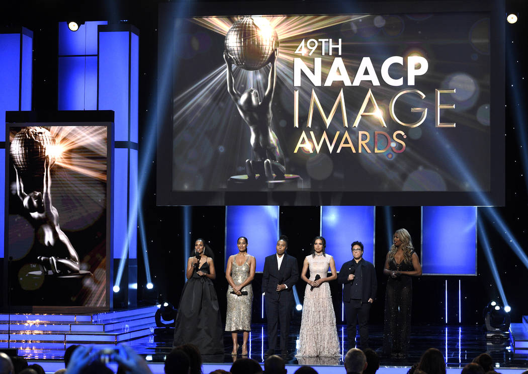 Kerry Washington, from left, Tracee Ellis Ross, Lena Waithe, Jurnee Smollett - Bell, Angela Robinson, and Laverne Cox walk on stage to present the award for outstanding actress in a motion picture ...
