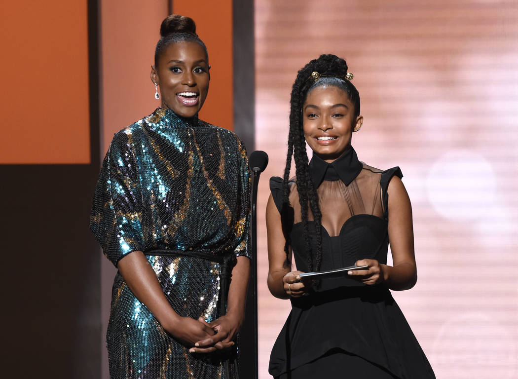 Issa Rae, left, and Yara Shahidi present the award for outstanding actor in a comedy at the 49th annual NAACP Image Awards at the Pasadena Civic Auditorium on Monday, Jan. 15, 2018, in Pasadena, C ...
