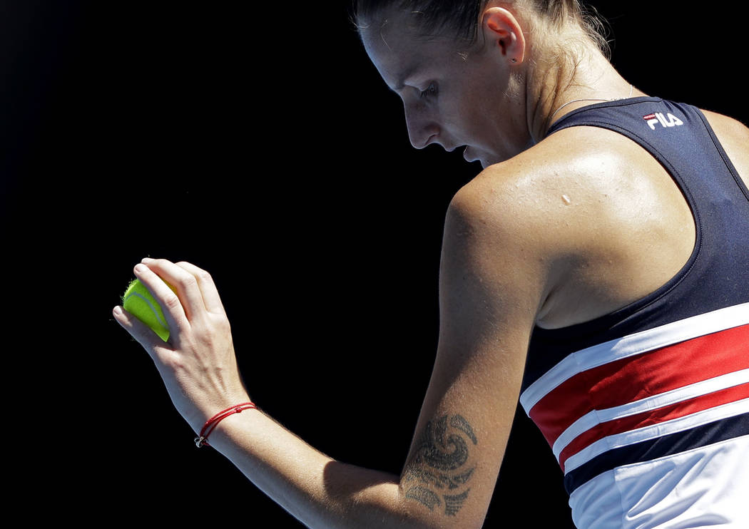 Karolina Pliskova of the Czech Republic prepares to serve to Paraguay's Veronica Cepede Royg during their first round match at the Australian Open tennis championships in Melbourne, Australia, Tue ...