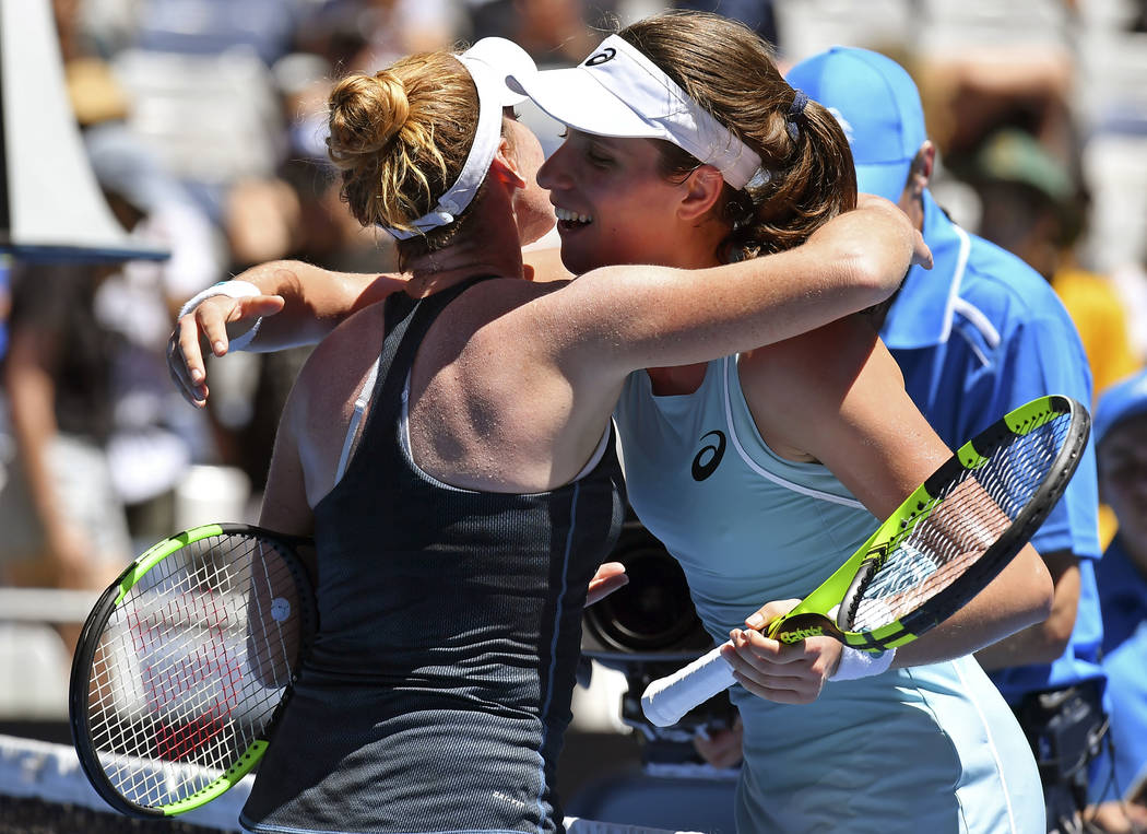 Britain's Johanna Konta, right, is congratulated by United States' Madison Brengle as she won their first round match at the Australian Open tennis championships in Melbourne, Australia, Tuesday,  ...
