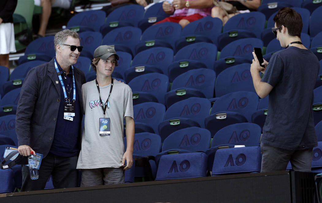 U.S. actor Will Ferrell, left, poses for a photo with spectators following the first round match between Karolina Pliskova of the Czech Republic and Paraguay's Veronica Cepede Royg at the Australi ...