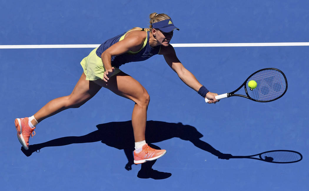 Germany's Angelique Kerber reaches for a return to compatriot Anna-Lena Friedsam during their first round match at the Australian Open tennis championships in Melbourne, Australia, Tuesday, Jan. 1 ...