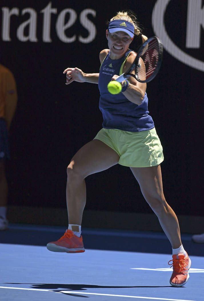 Germany's Angelique Kerber makes a backhand return to compatriot Anna-Lena Friedsam during their first round match at the Australian Open tennis championships in Melbourne, Australia, Tuesday, Jan ...
