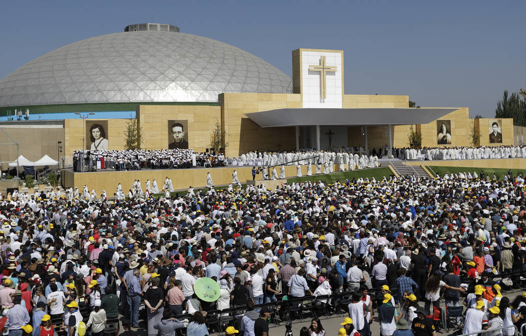 Pilgrims wait for Pope Francis to celebrate Mass at O'Higgins Park in Santiago, Chile, Tuesday, Jan. 16, 2018.  (Natacha Pisarenko/AP)