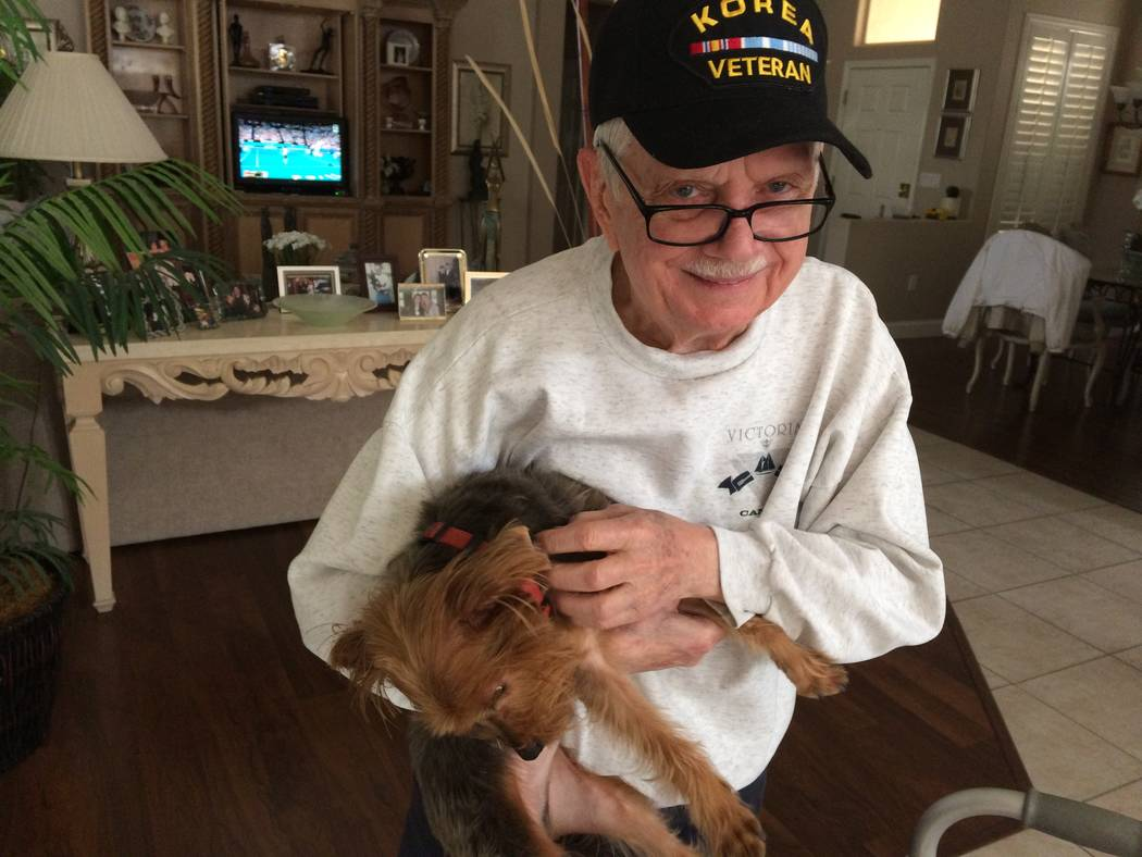 David Soifer, 89, holds his Yorkie, Buddy Jan. 4, 2018, in his Sun City Summerlin home. He was stationed in South Korea in the early 1950s and has been offered the chance to go on an Honor Flight  ...