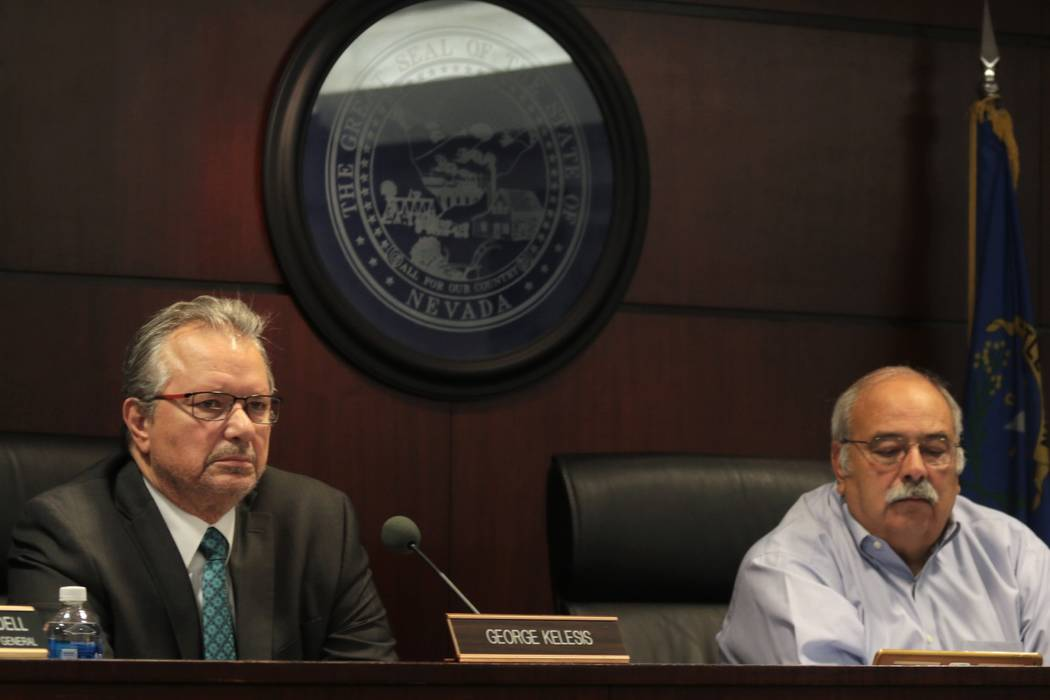 Nevada Tax Commission members George Kelesis, left, and Thom Sheets listen to a presentation on regulations for recreational marijuana sales in Las Vegas, Monday, May 8, 2017. (Colton Lochhead/Las ...