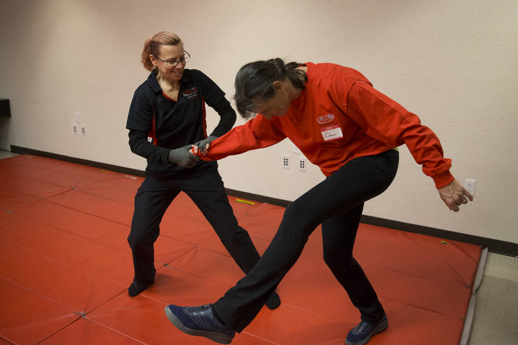 UNLV police Sgt. Denise Lutey, left, and police officer Eileen Wells, during a Girls on Guard self-defense training for women at the UNLV Police Headquarters in Las Vegas, Wednesday, Jan. 24, 2018 ...