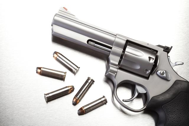 gun with bullets on steel THINKSTOCK