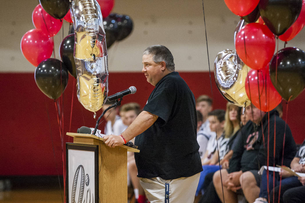 Boys' basketball coach Scott Berg shares his memories of Quinton Robbins, a victim of the Oct. 1 shooting, during a ceremony to honor him at the B. Mahlon Brown Academy of International Studies on ...